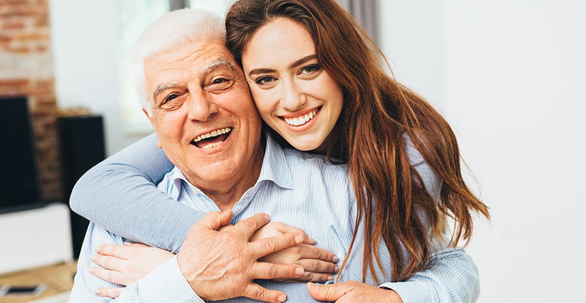 Beautiful woman with her father as they both smile