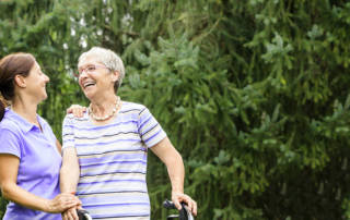 Two women outdoors laughing