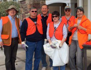 residents and volunteers in orange vests