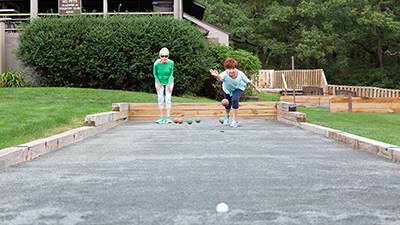 Two women playing bocce at Newberry Estate