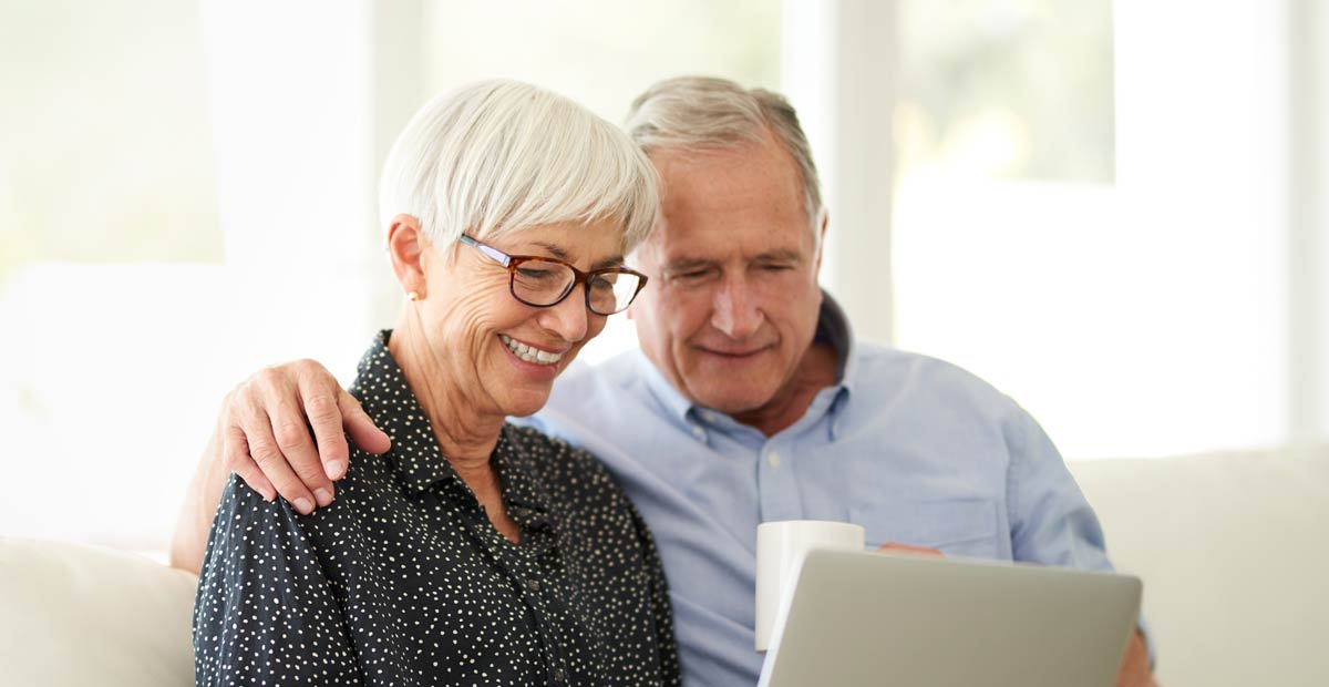 couple reviewing retirement living costs online