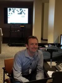 A staff member calls virtual bingo