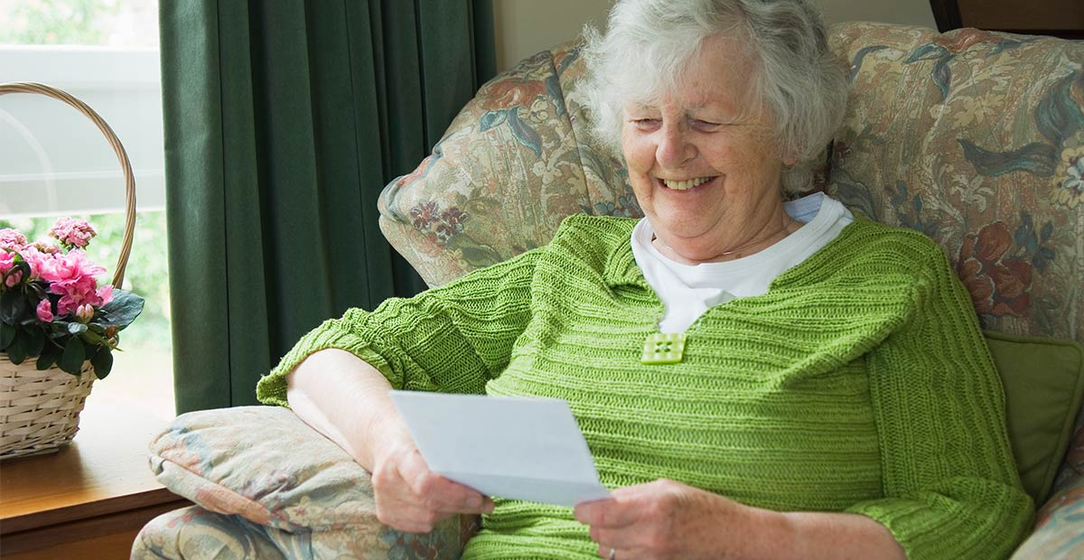 Older adult reading letter