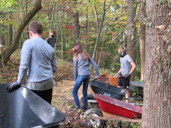 Volunteers build a walking trail